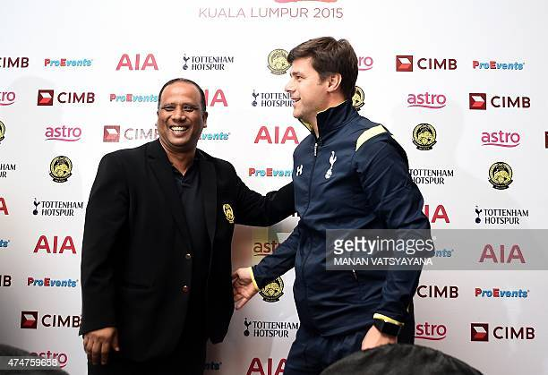 Tottenham Hotspur's Argentinian head coach Mauricio Pochettino and Malaysia's football coach Dollah Salleh pose after a press conference in Kuala...