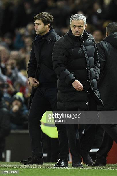 Tottenham Hotspur's Argentinian head coach Mauricio Pochettino and Manchester United's Portuguese manager Jose Mourinho walk from the pitch after the...