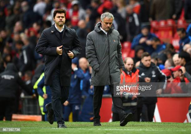 Tottenham Hotspur's Argentinian head coach Mauricio Pochettino and Manchester United's Portuguese manager Jose Mourinho walk off at half time in the...