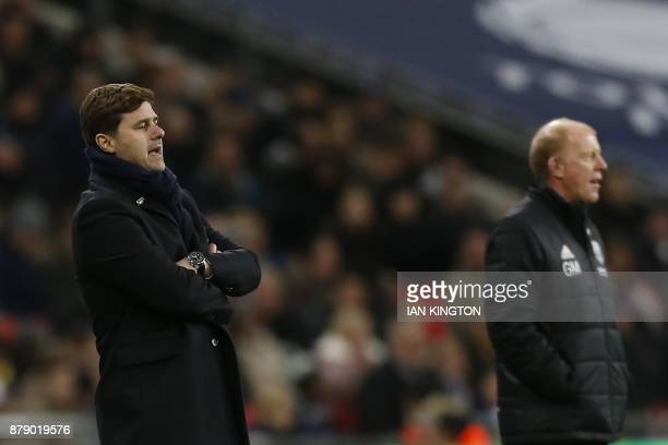 Tottenham Hotspur's Argentinian head coach Mauricio Pochettino and West Bromwich caretaker coach Gary Megson gesture during the English Premier...