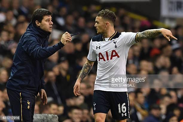 Tottenham Hotspur's Argentinian head coach Mauricio Pochettino gives instructions to Tottenham Hotspur's English defender Kieran Trippier during the...