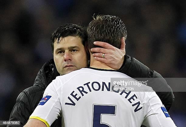 Tottenham Hotspur's Argentinian Head Coach Mauricio Pochettino consoles Tottenham Hotspur's Belgian defender Jan Vertonghen at the final whistle in...