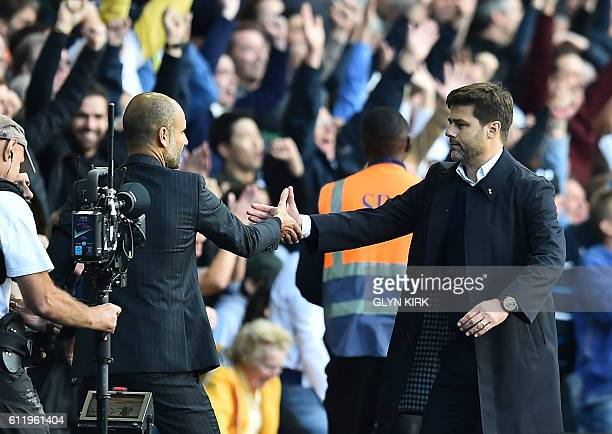 Tottenham Hotspur's Argentinian head coach Mauricio Pochettino shakes hands with Manchester City's Spanish manager Pep Guardiola after the English...