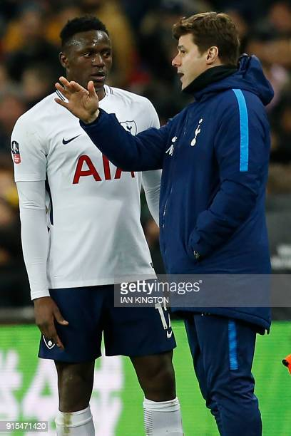 Tottenham Hotspur's Argentinian head coach Mauricio Pochettino speaks with Tottenham Hotspur's Kenyan midfielder Victor Wanyama during a break in...