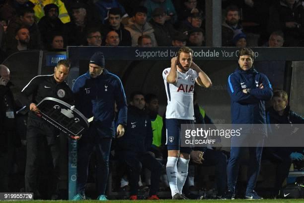 Tottenham Hotspur's Argentinian head coach Mauricio Pochettino prepares to bring on Tottenham Hotspur's English striker Harry Kane during the English...
