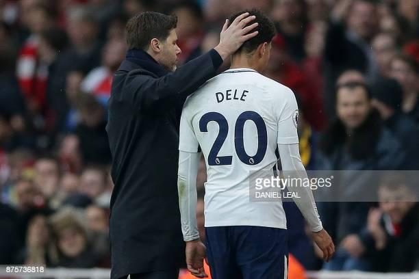 Tottenham Hotspur's Argentinian head coach Mauricio Pochettino tpas Tottenham Hotspur's English midfielder Dele Alli on the head as he leaves the...
