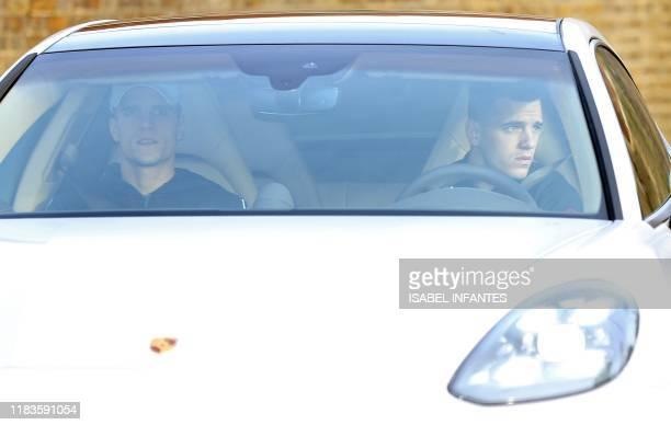 Tottenham Hotspur's Argentinian midfielder Erik Lamela and Tottenham Hotspur's Argentinian midfielder Giovani Lo Celso arrive at Tottenham Hotspur's...