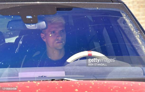 Tottenham Hotspur's Argentinian midfielder Erik Lamela arrives at the Tottenham training ground in north London on May 19 as training resumes for the...