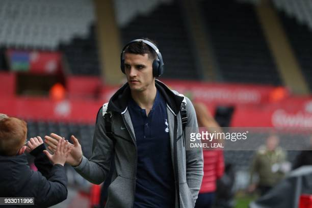 Tottenham Hotspur's Argentinian midfielder Erik Lamela arrives for the English FA Cup quarterfinal football match between Swansea City and Tottenham...
