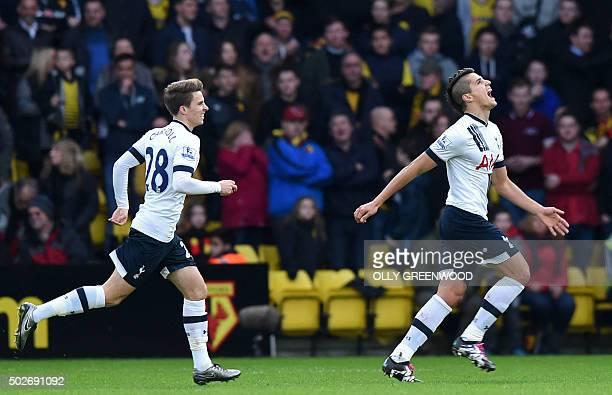 Tottenham Hotspur's Argentinian midfielder Erik Lamela celebrates with Tottenham Hotspur's English midfielder Tom Carroll after scoring the opening...