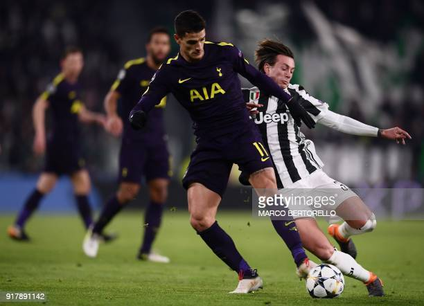 Tottenham Hotspur's Argentinian midfielder Erik Lamela fights for the ball with Juventus' forward Federico Bernardeschi during the UEFA Champions...