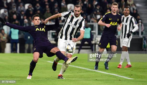 Tottenham Hotspur's Argentinian midfielder Erik Lamela fights for the ball with Juventus' defender from Italy Giorgio Chiellini during the UEFA...