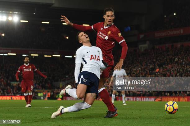 TOPSHOT Tottenham Hotspur's Argentinian midfielder Erik Lamela goes down from a tackle by Liverpool's Dutch defender Virgil van Dijk leading to the...