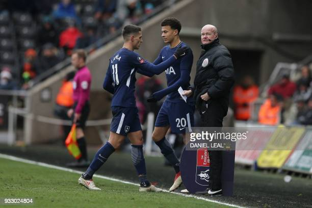 Tottenham Hotspur's Argentinian midfielder Erik Lamela goes off to be replaced by Tottenham Hotspur's English midfielder Dele Alli during the English...