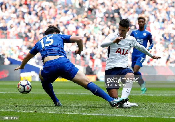 Tottenham Hotspur's Argentinian midfielder Erik Lamela has a shot deflected in to score during the English Premier League football match between...