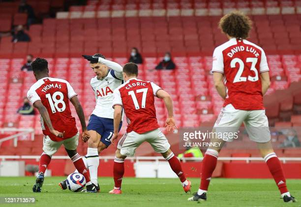Tottenham Hotspur's Argentinian midfielder Erik Lamela kicks a rabona shot to score the opening goal during the English Premier League football match...