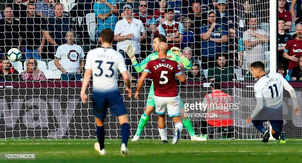Tottenham Hotspur's Argentinian midfielder Erik Lamela scores their first goal during the English Premier League football match between West Ham...
