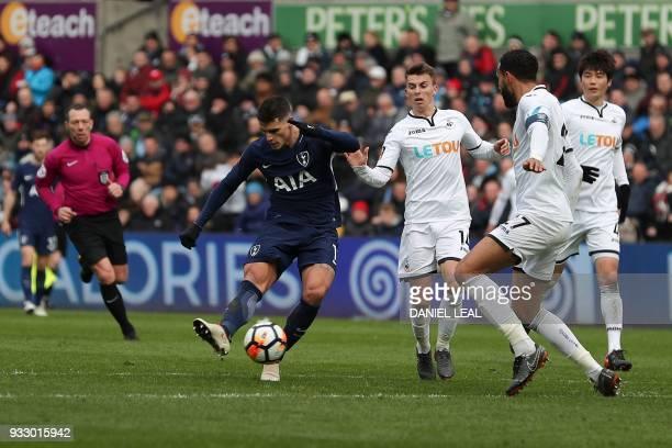 Tottenham Hotspur's Argentinian midfielder Erik Lamela scores their second goal during the English FA Cup quarterfinal football match between Swansea...