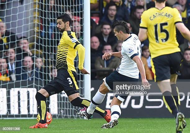 Tottenham Hotspur's Argentinian midfielder Erik Lamela shoots to score the opening goal of the English Premier League football match between Watford...