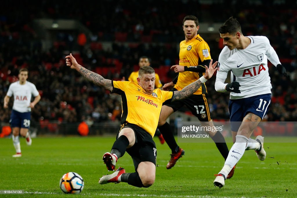 Tottenham Hotspur's Argentinian midfielder Erik Lamela (R) shoots to score their second goal during the English FA Cup fourth round replay football match between Tottenham Hotspur and Newport County at Wembley Stadium in London, on February 7, 2018. / AFP PHOTO / Ian KINGTON / RESTRICTED TO EDITORIAL USE. No use with unauthorized audio, video, data, fixture lists, club/league logos or 'live' services. Online in-match use limited to 75 images, no video emulation. No use in betting, games or single club/league/player publications. /