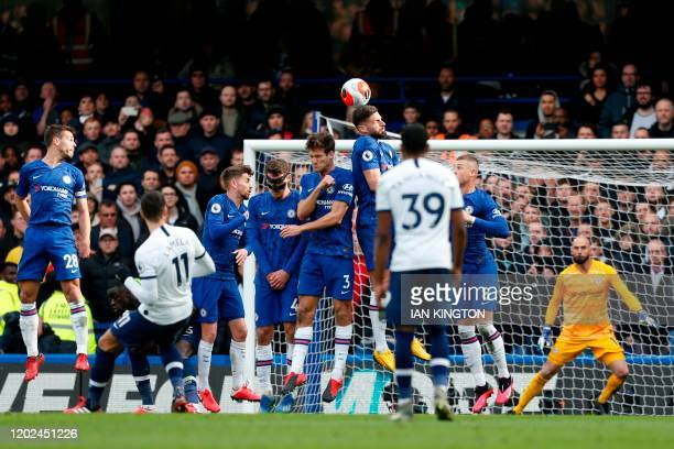 Tottenham Hotspur's Argentinian midfielder Erik Lamela takes a free kick and hits the wall during the English Premier League football match between...