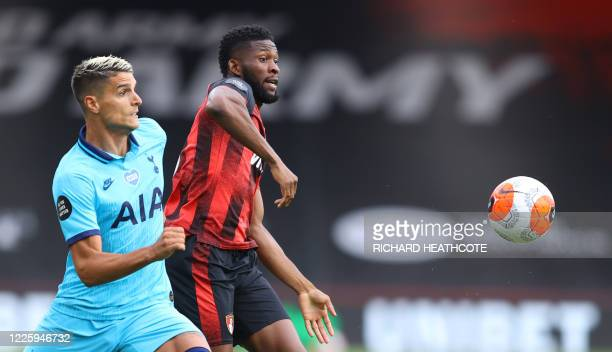 Tottenham Hotspur's Argentinian midfielder Erik Lamela vies for the ball with Bournemouth's Colombian midfielder Jefferson Lerma during the English...
