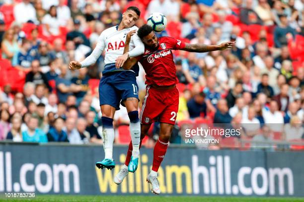 Tottenham Hotspur's Argentinian midfielder Erik Lamela vies with Fulham's Irish defender Cyrus Christie during the English Premier League football...