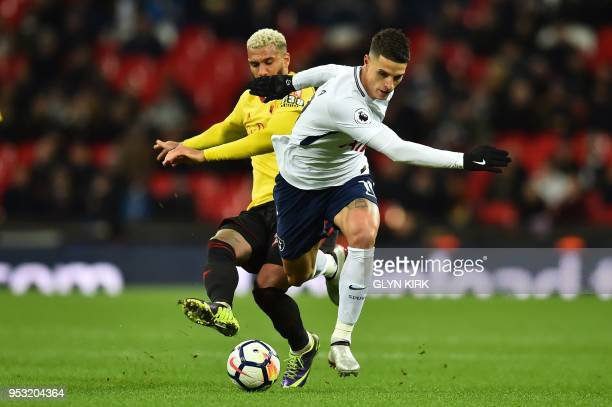 Tottenham Hotspur's Argentinian midfielder Erik Lamela vies with Watford's French midfielder Etienne Capoue during the English Premier League...