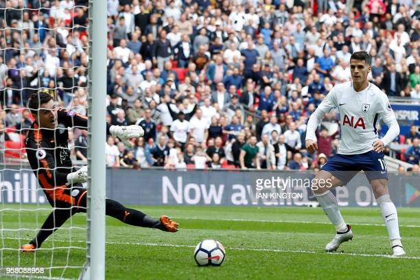 Tottenham Hotspur's Argentinian midfielder Erik Lamela watches his shot beat Leicester City's Bosnianborn Swiss goalkeeper Eldin Jakupovic for their...