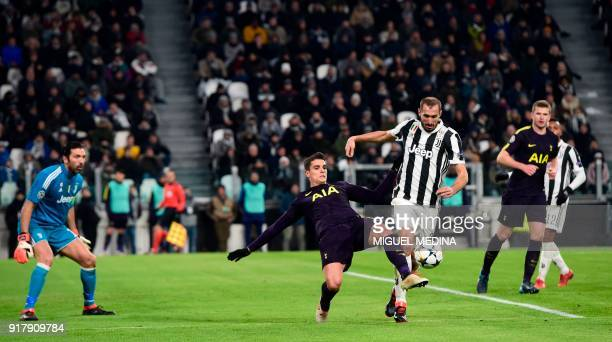 Tottenham Hotspur's Argentinian midfielder Erik Lamelafights for the ball with Juventus' defender from Italy Giorgio Chiellini as Juventus'...