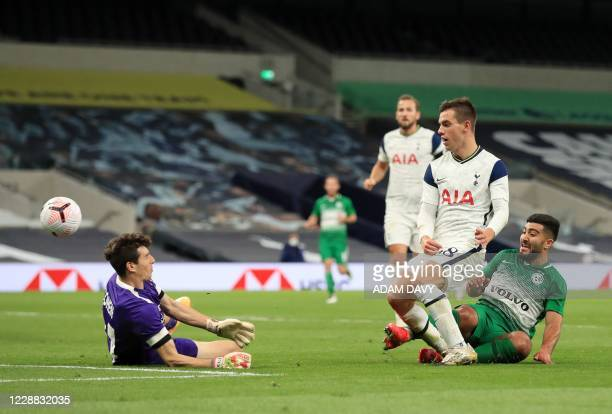 Tottenham Hotspur's Argentinian midfielder Giovani Lo Celso scores his team's fourth goal during the UEFA Europa League qualifying round football...