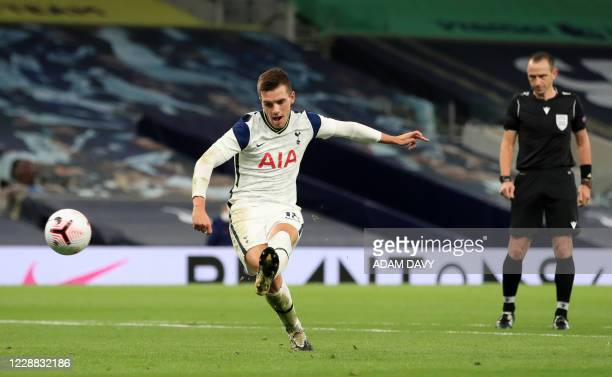 Tottenham Hotspur's Argentinian midfielder Giovani Lo Celso scores his team's third goal during the UEFA Europa League qualifying round football...
