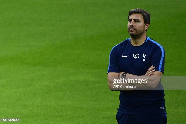 Tottenham Hotspur's assitant coach Miguel D'Agostino attends a training session in Madrid on October 16 2017 on the eve of the UEFA Champions League...