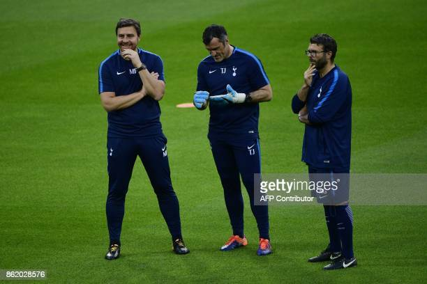 Tottenham Hotspur's assitant coach Miguel D'Agostino goalkeeping coach Toni Jimenez and fitness coach Nathan Gardiner attend a training session in...