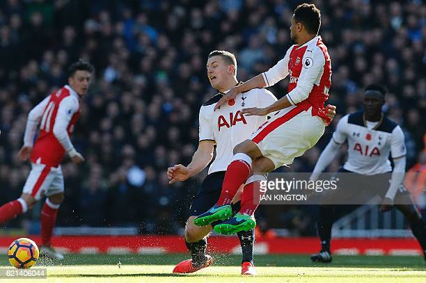 TOPSHOT Tottenham Hotspur's Austrian defender Kevin Wimmer fouls Arsenal's French midfielder Francis Coquelin resulting in a yellow card during the...