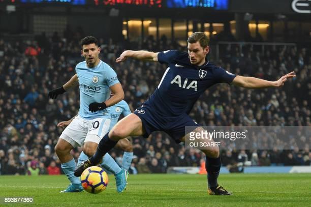 Tottenham Hotspur's Belgian defender Jan Vertonghen blocks by Manchester City's Argentinian striker Sergio Aguero during the English Premier League...