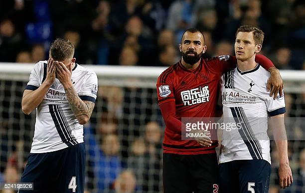 Tottenham Hotspur's Belgian defender Jan Vertonghen is embraced by West Bromwich Albion's Brazilian midfielder Sandro as Tottenham Hotspur's Belgian...