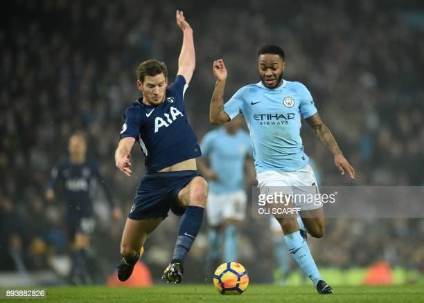 Tottenham Hotspur's Belgian defender Jan Vertonghen tackles Manchester City's English midfielder Raheem Sterling during the English Premier League...