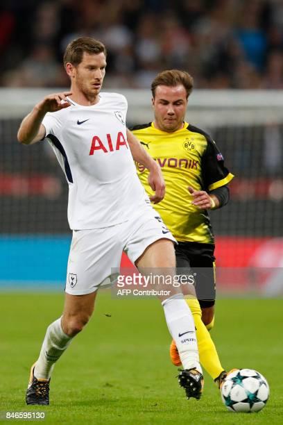 Tottenham Hotspur's Belgian defender Jan Vertonghen vies with Borussia Dortmund's German striker Mario Goetze during the UEFA Champions League Group...