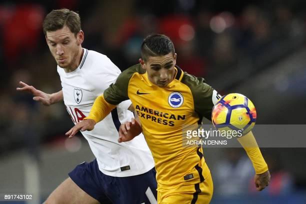 Tottenham Hotspur's Belgian defender Jan Vertonghen vies with Brighton's French midfielder Anthony Knockaert during the English Premier League...