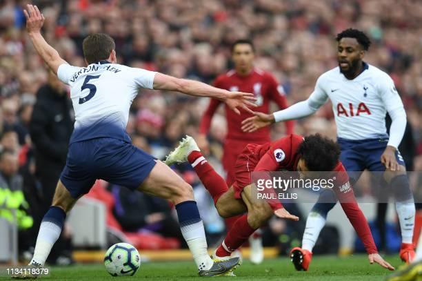 Tottenham Hotspur's Belgian defender Jan Vertonghen vies with Liverpool's Egyptian midfielder Mohamed Salah during the English Premier League...