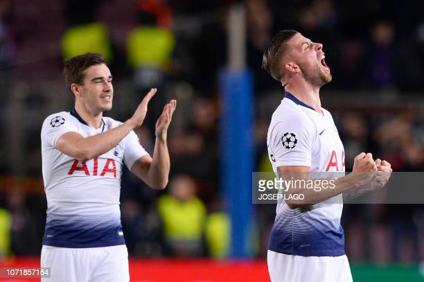 Tottenham Hotspur's Belgian defender Toby Alderweireld and Tottenham Hotspur's English midfielder Harry Winks celebrate their qualification for the...
