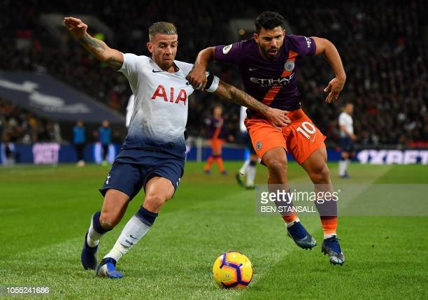 Tottenham Hotspur's Belgian defender Toby Alderweireld vies with Manchester City's Argentinian striker Sergio Aguero during the English Premier...