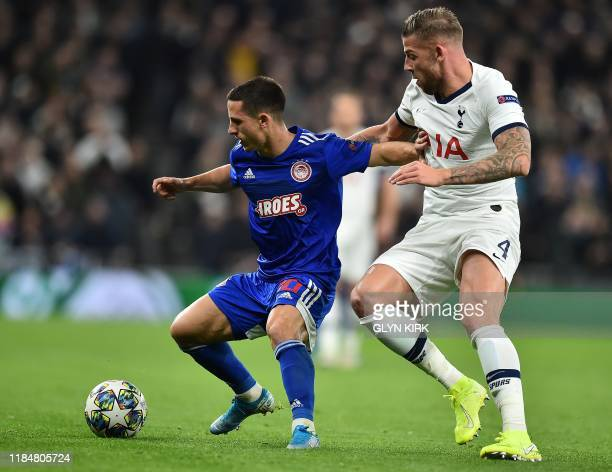 Tottenham Hotspur's Belgian defender Toby Alderweireld vies with Olympiakos' Portuguese midfielder Daniel Podence during the UEFA Champions League...
