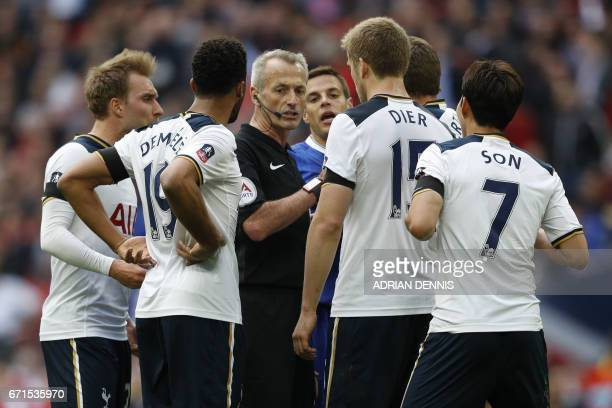 Tottenham Hotspur's Belgian midfielder Mousa Dembele and Tottenham Hotspur's English defender Eric Dier react after a penalty decision during the FA...