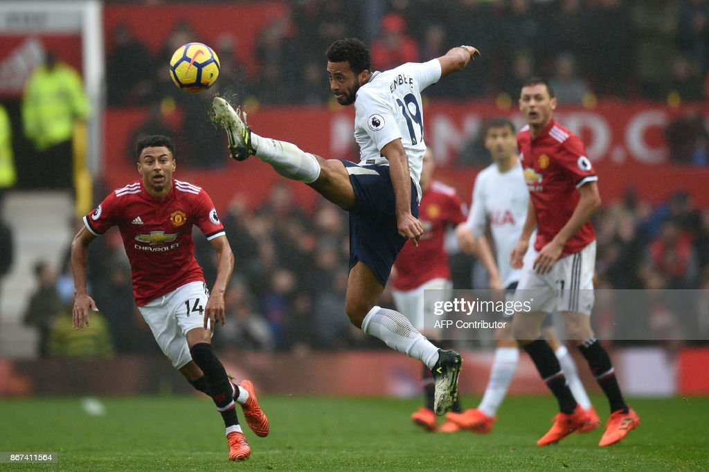 Tottenham Hotspur's Belgian midfielder Mousa Dembele (C) controls the ball during the English Premier League football match between Manchester United and Tottenham Hotspur at Old Trafford in Manchester, north west England, on October 28, 2017. Manchester United won the game 1-0. / AFP PHOTO / Oli SCARFF / RESTRICTED TO EDITORIAL USE. No use with unauthorized audio, video, data, fixture lists, club/league logos or 'live' services. Online in-match use limited to 75 images, no video emulation. No use in betting, games or single club/league/player publications. /