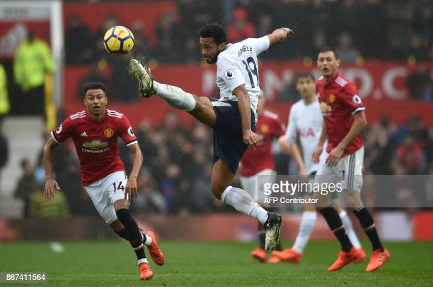 Tottenham Hotspur's Belgian midfielder Mousa Dembele controls the ball during the English Premier League football match between Manchester United and...
