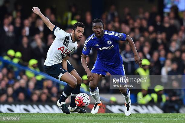 Tottenham Hotspur's Belgian midfielder Mousa Dembele vies with Chelsea's Nigerian midfielder John Obi Mikel during the English Premier League...