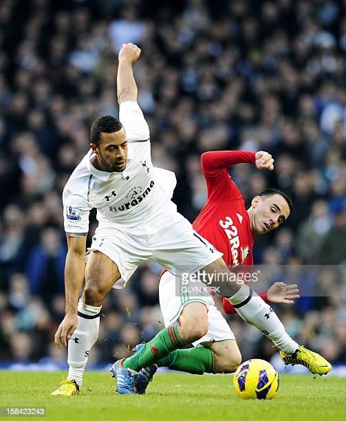 Tottenham Hotspur's Belgian midfielder Moussa Dembele vies with Swansea City's English midfielder Leon Britton during their English Premier League...