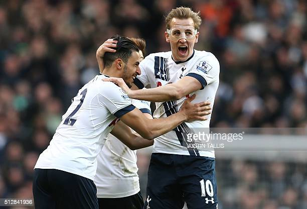 Tottenham Hotspur's Belgian midfielder Nacer Chadli celebrates with Tottenham Hotspur's English striker Harry Kane after scoring their first goal...